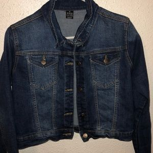 A cropped  jean jacket . Amazing condition